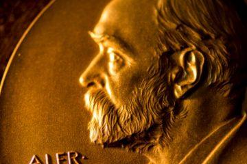Detalle de una medalla Nobel como portada del episodio de Coffee Break: Gala Nobel 2019 y machine learning en cosmología